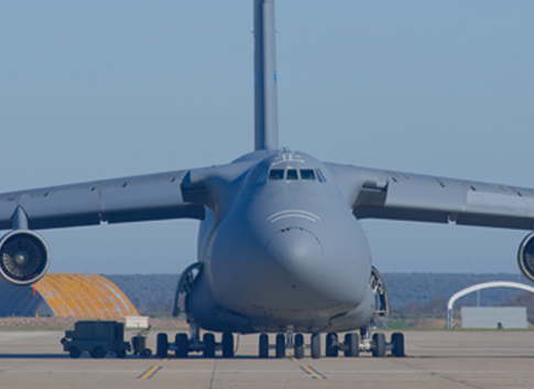 Image of military transport plane as a symbol for bringing the promises of additive manufacturing to the supply chain.